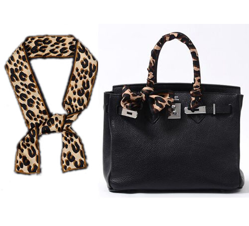 animal print scarf tied on purse handle